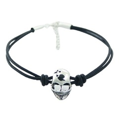 Double leather bracelet with silver skull