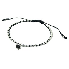 Macrame bracelet with silver tube beads and silver flower charm